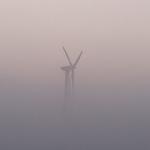 Wind turbine in fog